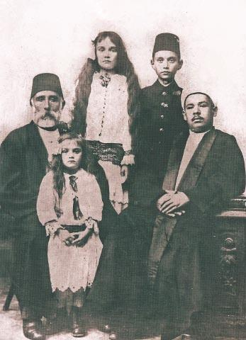 Left to Right: Ahmet Sarac Efendi(2nd Generation),inhis lap grandaughter from first wife Naciye's son,: Ferhunde. Standing Nudiye and Huseyin , children from 2nd wife.Sabiye, and son Ali Bey from Naciye